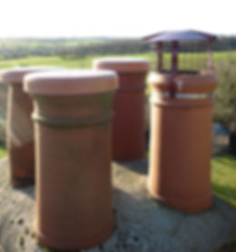 A brand new bird guard and three vent caps fitted to chimney pots