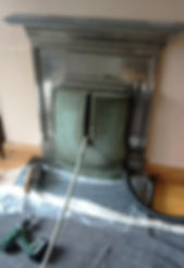 Us chimney Sweeping a fireplace