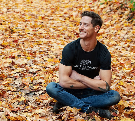 Noreaster-Apparel-mens-crew-neck-black-tshirt man sitting on leaves