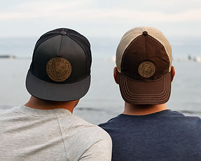 Nor'easter Apparel trucker hat and dad hat worn by guys in Point Pleasant Park, Halifax
