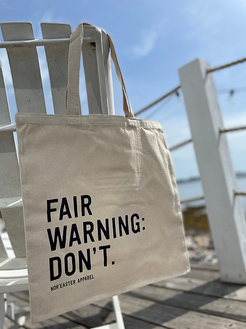Noreaster Apparel Fair Warning Reusable Tote Bag front view, natural colour canvas with navy ink