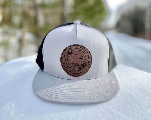 Noreaster-Apparel-Trucker-Hat-Light-grey sitting on snow