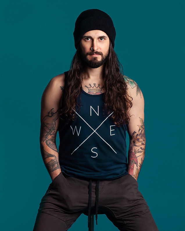 Noreaster Apparel mens compass tank worn by bearded guy with tattoos wearing a toque
