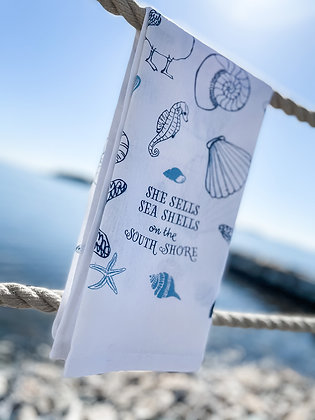 Far Far Away Shop, Sea Shell Collage Tea Towel front view in navy