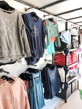 Wall of clothing inside noreaster apparel fashion truck