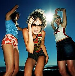 Three women dancing in the sun
