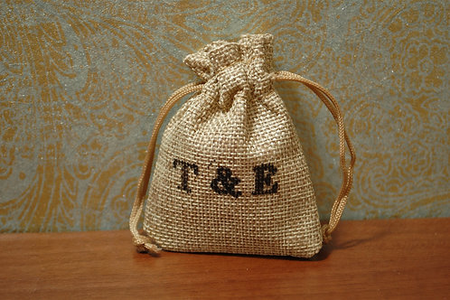 Hessian confetti personalised initial bags, filled with biodegradable rose petal