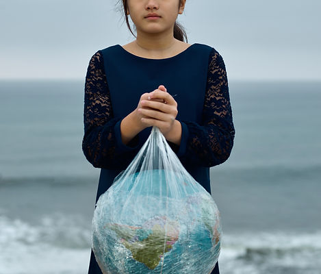 calm-girl-with-globe-in-plastic-bag-near
