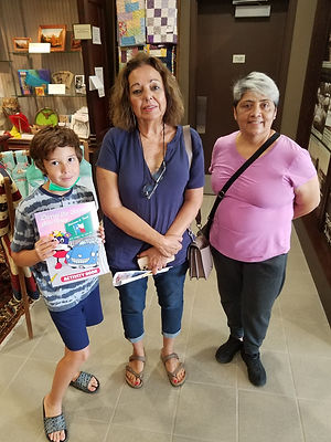 Austin shows off his prize from his Scavenger hunt with his grandmother and family friend