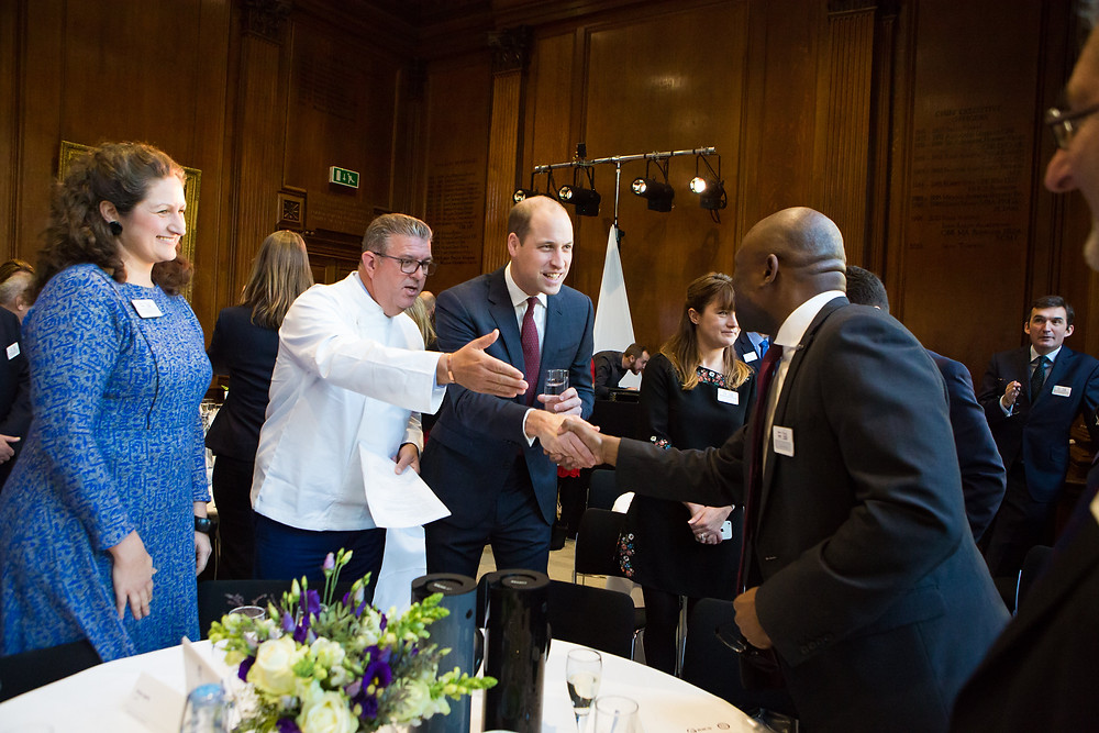 Sean Tompkins, explains the need for diversity & inclusion and introduces Chair, Bola Abisogun FRICS [founder, DiverseCity Surveyors] to the Duke of Cambridge....
