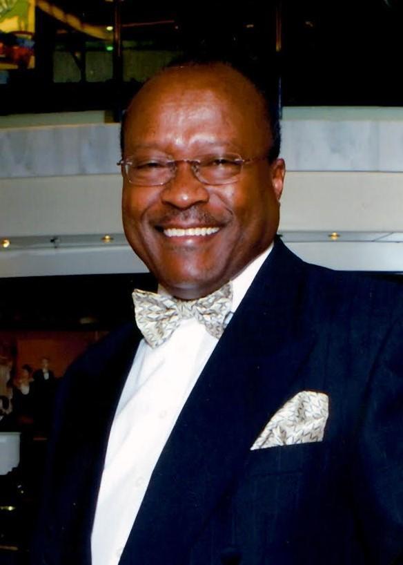 Simon Paul Olimi-Kabuzi LLB MRICS MCIArb MAE