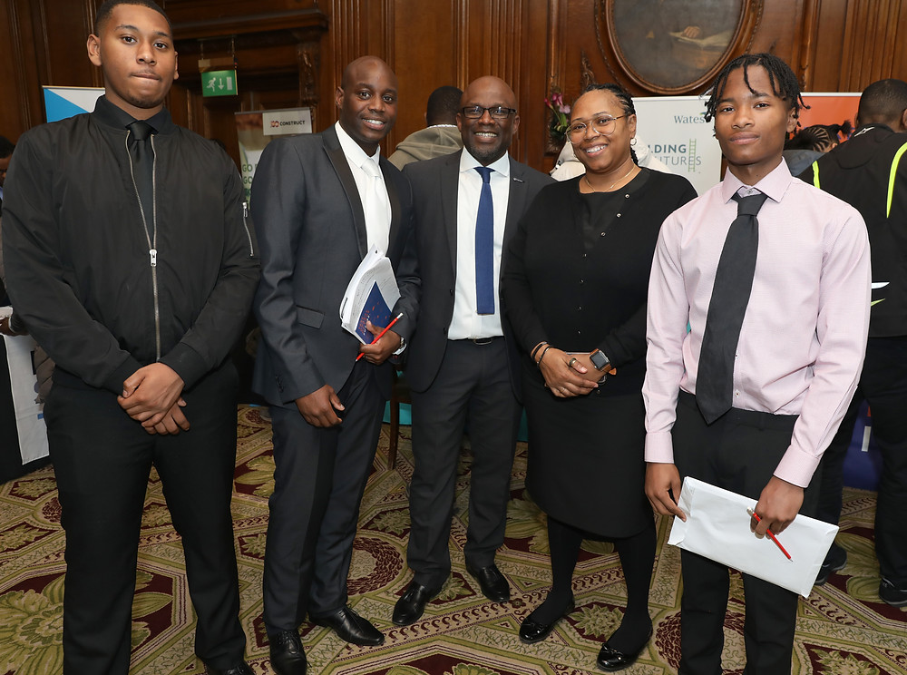 Norma Odain-Hines from Wates, [second from right] along with Bola and attendees