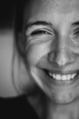 woman with freckles smiling