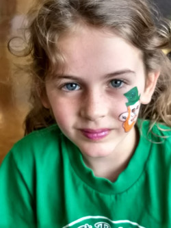 Girl with the St. Patrick's Day spirit at Whole Foods Market 2018.