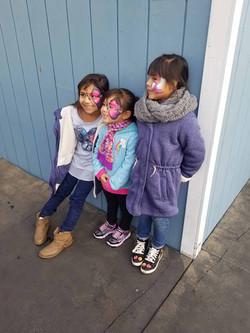 3 Smiling Girls Having Fun