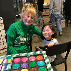 An extremely animated delightful girl painted at Whole Foods Market Redwood City on St. Pattys Day 2