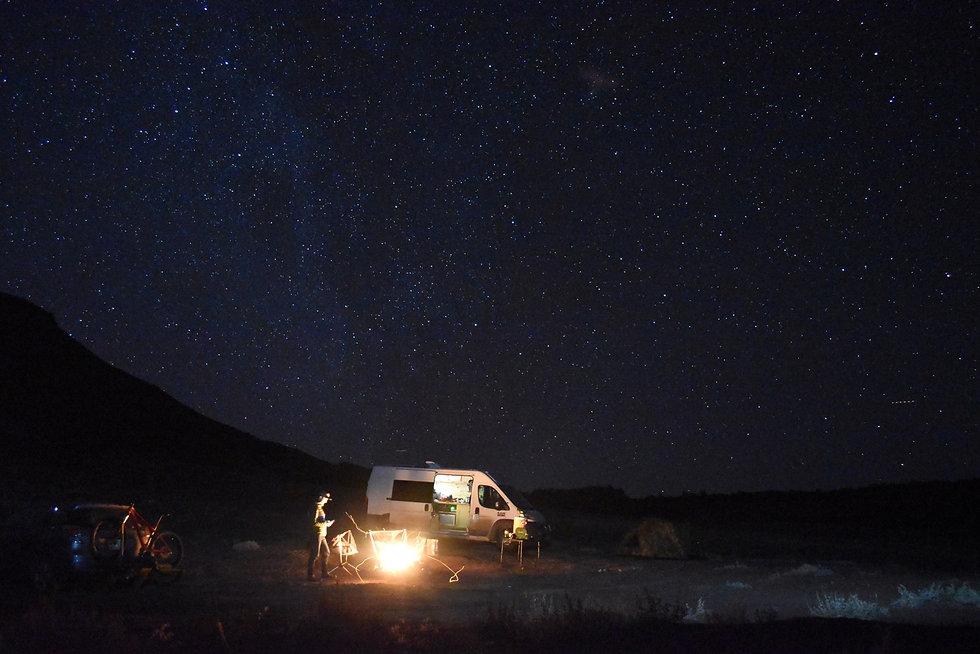 Custom camper van with desert night sky.