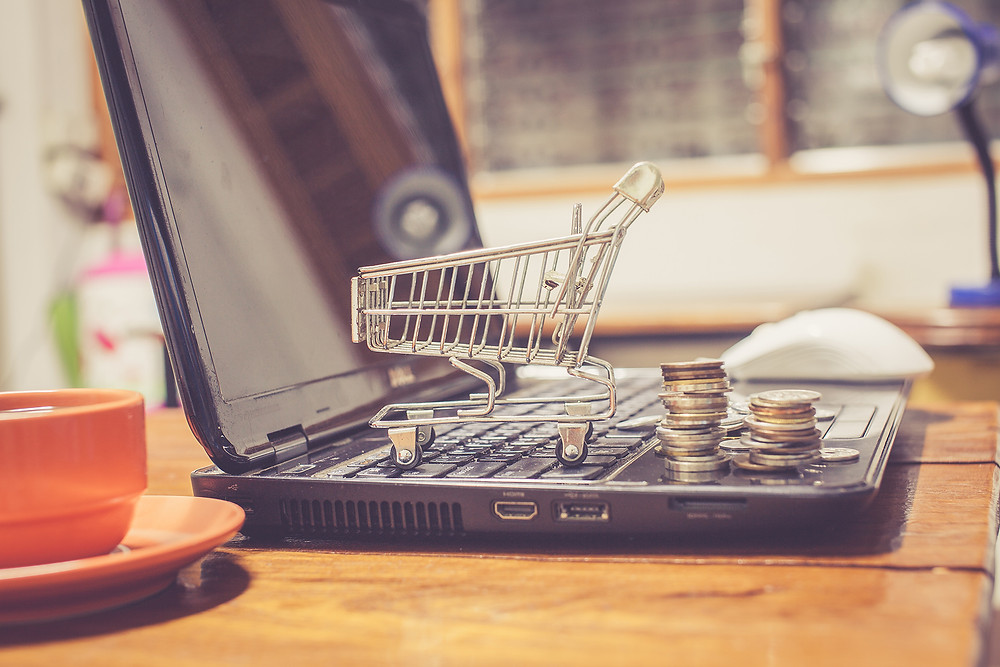 ecommerce laptop with shopping cart