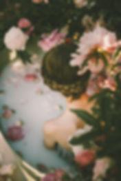 woman in flower bath postpartum