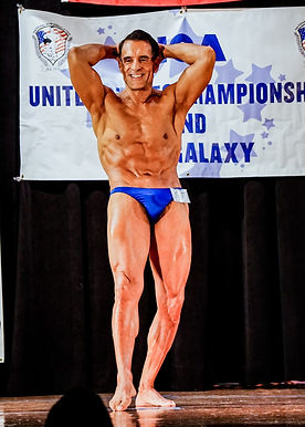 Actor, Model, Playwright, Bodybuilder Gregory Cole doing Ab Crunch on stage