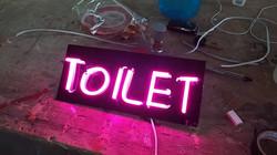neon signage toilet