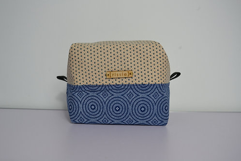White and blue fabric box shaped cosmetic bag