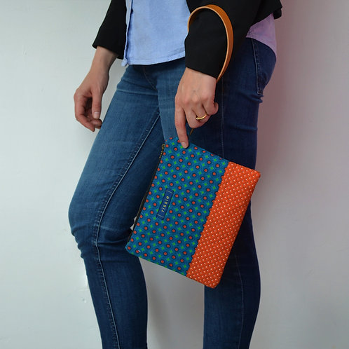 Blue and orange shweshwe fabric clutch bag with brown leather wrist strap