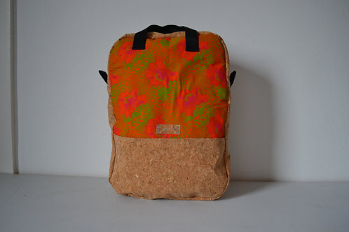 Cork and orange fabric backpack with black webbing straps