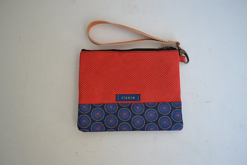Blue and red fabric clutch bag with brown leather wrist strap