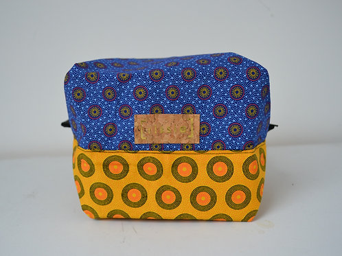 Blue and yellow fabric box shaped toiletry bag