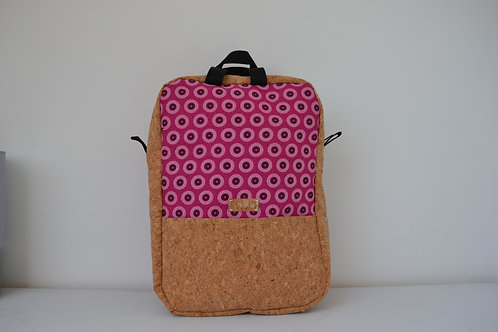 Cork and pink fabric backpack with black webbing straps