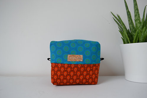 Turquoise and orange fabric box shaped cosmetic bag