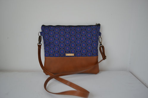 Genuine leather and indigo fabric crossbody bag