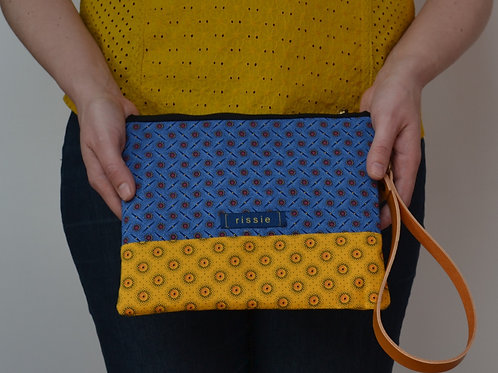 Blue and yellow fabric clutch bag for women with brown leather wrist strap