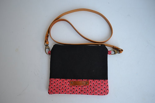 Black and red fabric clutch bag with leather strap. Crossbody/wrist strap option