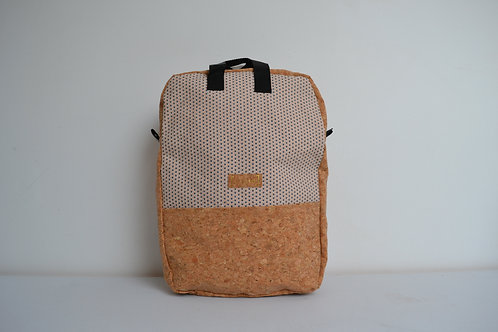 Cork and white fabric backpack with black webbing straps