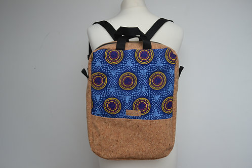 Cork and blue fabric backpack with black webbing straps