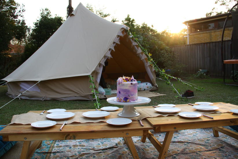 Custom birthday cake with tent and picnic tables