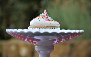 Vanilla buttercream cupcake on white platter