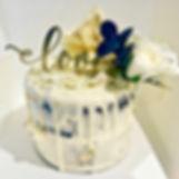 Vanilla buttercream drip engagement cake