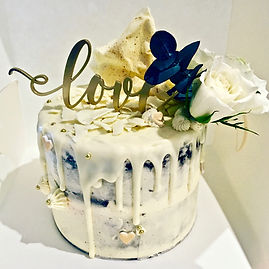 Vanilla buttercream drip engagement cake
