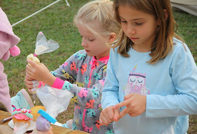 children doing cupcake decorating activity