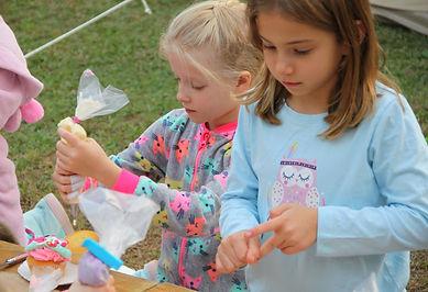 children doing cupcake decorating activity