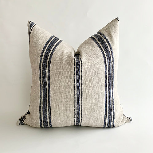 Wheat Cushion with a Black and Blue Stripe