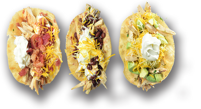 Three chicken tacos from Skillets Restaurants with assorted toppings