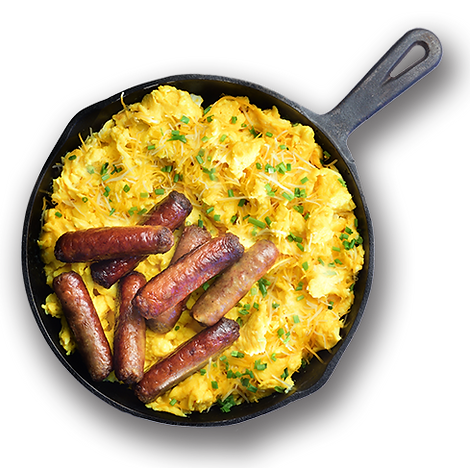 Cast iron skillet with scrambled eggs and sausage links