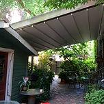 Retrofit retractable roof