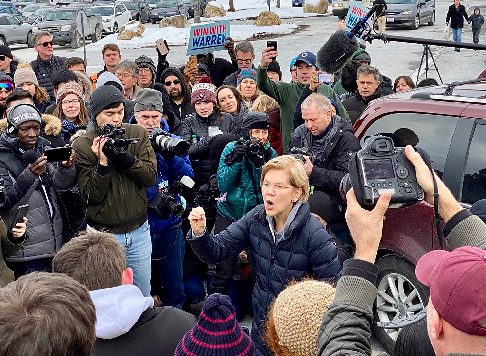 Elizabeth Warren talks to a crowd of overflow supporters at an event in Manchester, N.H.