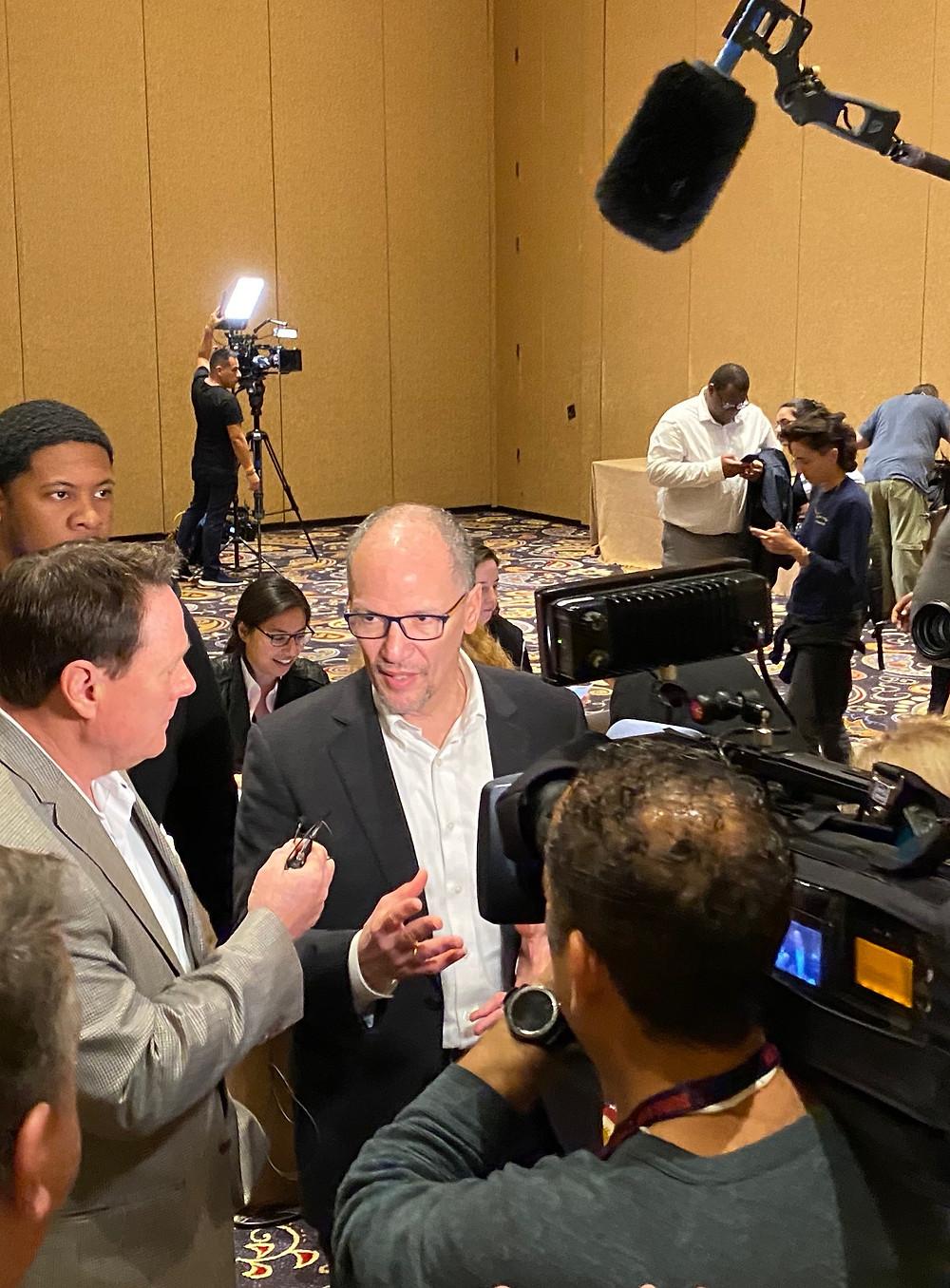 Tom Perez talks to media at the strip caucus at the Bellagio casino in Las Vegas.