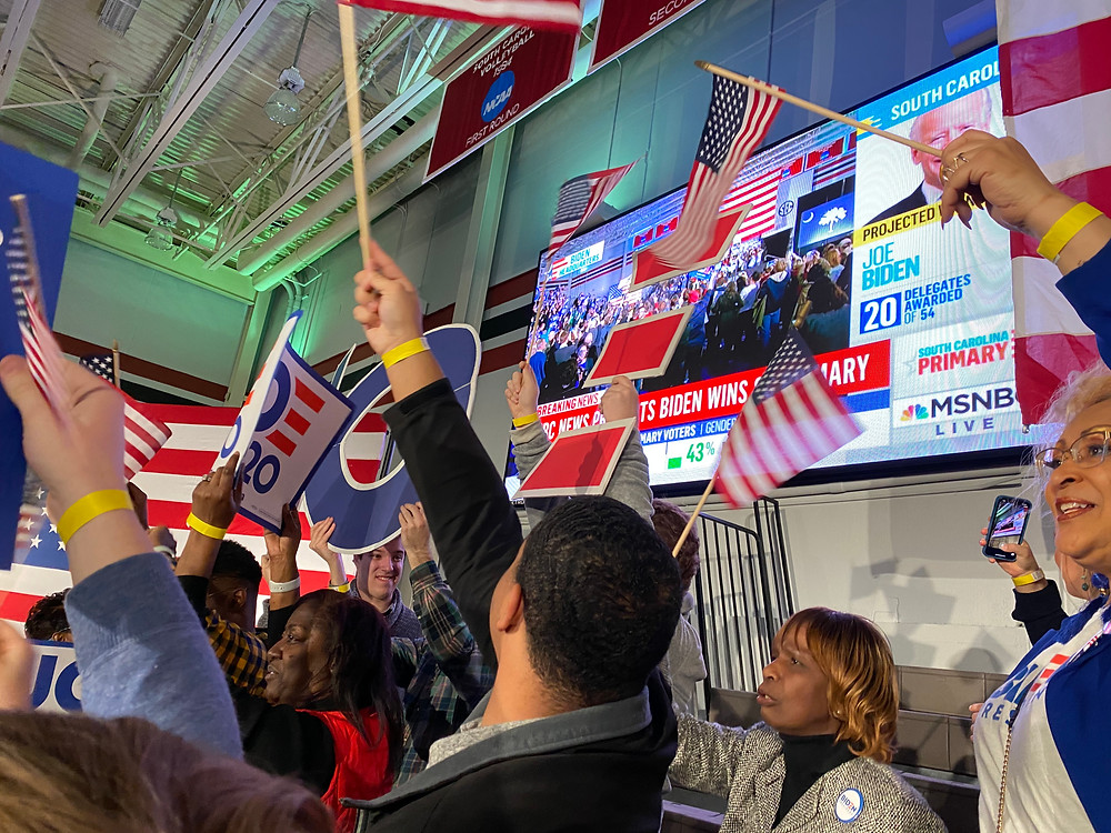 Supporters cheer as MSNBC calls the South Carolina primary for Joe Biden immediately after the polls closed on Saturday, at a Biden rally in Columbia, S.C.